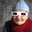 Stock Photo: Elderly womwith anaglyph 3D glasses