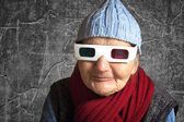 Elderly woman with anaglyph 3D glasses — Stock Photo