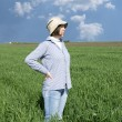 Female farmer in a weath field. - Stock Photo