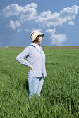 Female farmer in a weath field. — Stock Photo