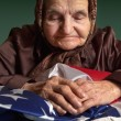 Elderly woman with American flag — Stock Photo