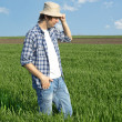 Farmer in a wheat field. — Stock Photo