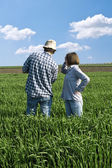Two farmers in a wheat field. — Stock Photo