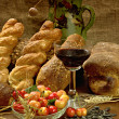 Still life with bread, cherrys, and wine — Stock Photo