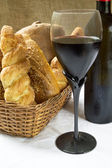 Still life assortment of bread with a glass of red wine and bott — Stock Photo