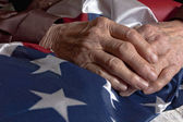 Hands holding an American flag — Stock Photo