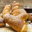 Still life assortment of bread with a glass of red wine. — Stock Photo