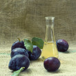 Постер, плакат: Plum brandy or schnapps and tasty plum fruit