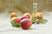 Fresh and tasty apricot fruit and apricot brandy on a table clot — Stock Photo