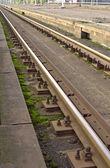 Trilhos na estação — Fotografia Stock