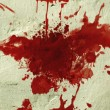Stock Photo: Red blood splatter on wall.