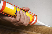 Caulking silicone on wooden batten. — Stock Photo