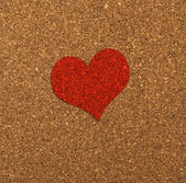 Red heart on a cork board. — Stock Photo