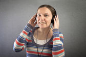 Portrait of a beautiful woman with headphones. — Stock Photo