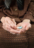 Senior woman holding assorted capsules in her hands. — Stock Photo
