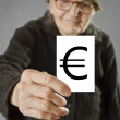 Elderly woman holding card with printed euro mark — Stock Photo #42015725