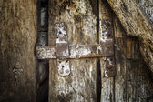 Old latch on the old wooden door. — Stock Photo