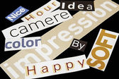 Words clipped from magazines on black background. — Stock Photo