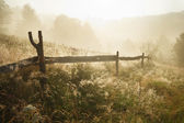 Misty morning with wooden fence in Transylvania — Stock Photo