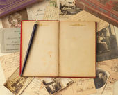 Vintage background with old post cards and empty open book — Stock Photo