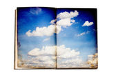 Old book with sky illustration — Stock Photo