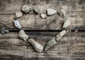 Stone heart on old wood texture — Stock Photo