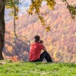 Stock Photo: Mtaking photos under autumn tree