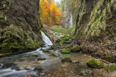 Autumnal creek with beautiful mossy stones and blue water in Transylvania — Stock Photo