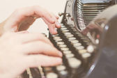 Hands writing on old typewriter — Stock Photo