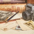 Stock Photo: Retro camera, old photos, letters and books with pen composition