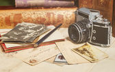 Retro camera, old photos, letters and books with pen composition — Stock Photo
