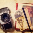 Stock Photo: Background with vintage photo, money, postal card, and empty open book and camera