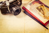 Background with vintage photo, money, postal card, and empty open book and camera — 图库照片