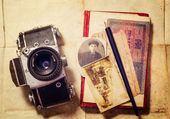 Background with vintage photo, money, postal card, and empty open book and camera — Stock Photo