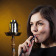 Glamor girl smokes a hookah — Stock Photo