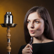 Stock Photo: Glamor girl smokes a hookah