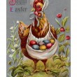 A vintage Easter postcard of a hen carrying colored Easter eggs — Stock Photo #12092617