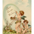 A vintage Easter postcard of two cherubs painting an Easter egg — Stockfoto