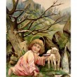 A vintage Easter postcard of a little angel with a lamb by the r — Stockfoto