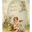 A vintage Easter postcard of a cupid making arrows and a large E — 图库照片