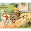 A vintage Easter postcard of a chick riding on an Easter wagon p — Stock Photo