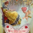Stock Photo: Vintage Valentines Day card with wompulling in heart wi