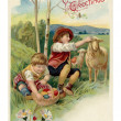 Stockfoto: Vintage Easter postcard of two boys on Easter egg hunt