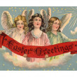 A vintage Easter postcard of three angels holding a banner - Stok fotoğraf