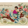 Stockfoto: Vintage Easter postcard with cherub riding antique car fu