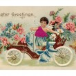 Stock Photo: Vintage Easter postcard with cherub riding antique car fu
