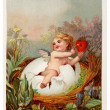 Foto Stock: Vintage Easter postcard with cherub holding key and heart
