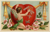A vintage Valentines card with a cherub patching up a broken hea — Foto Stock