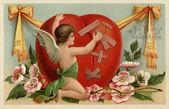 Um cartão de dia dos namorados vintage com um querubim remendar um hea quebrado — Foto Stock