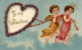 A vintage To My Valentine card with two cherubs pulling a heart — Stock Photo